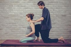 Traditional Thai Massage of a pregnant woman Royalty Free Stock Image