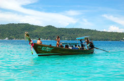 Traditional Thai motor boat with tourists Stock Photography