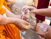 Traditional thai new year. Monk hand waiting for water from people represent celebrating thai new year Stock Photos
