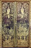 Traditional Thai painting art in temple. Pattern in traditional Thai style art painting on door of the temple Royalty Free Stock Photo