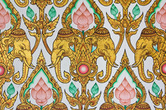 Traditional Thai pattern design on wal. Traditional Thai elephant and lotus flower pattern design on wall Royalty Free Stock Photo