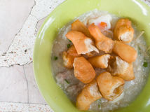 Traditional thai porridge rice gruel in white bowl congee. In th Stock Images