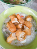 Traditional thai porridge rice gruel in white bowl congee. In th Royalty Free Stock Photo