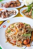 Traditional Thai`s food,Spicy papaya salad with herbs. Traditional Thai`s food, known as Som tam, Spicy papaya salad with herbs Royalty Free Stock Photography