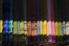 Traditional Thai scarves. Colorful Thai scarves sold at floating market stock photo