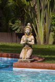 Traditional Thai sculpture and swimming pool in tropical garden. Thailand Stock Photos