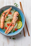 Traditional Thai soup with scampi and noodles stock images