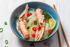 Traditional Thai soup with scampi Stock Images