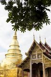 Traditional Thai style architecture public temple in North of Thailand. Wooden temple and gold pagoda Royalty Free Stock Images