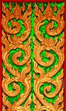 Traditional thai style art carving. At the door of temple Stock Image