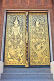 Traditional Thai style art on the door Stock Photo