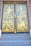 Traditional Thai style art gold painting pattern on the door Stock Image
