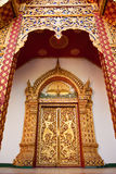 Traditional  Thai style Buddhist church door Stock Photos