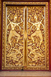 Traditional  Thai style Buddhist church door Stock Image