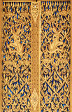 Traditional Thai Style Carving on the Door Stock Image