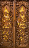 Traditional Thai style church door. Buddhist art stock photography