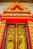 Traditional Thai style church door. The pattern at the door of the temple in Thailand stock images