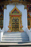 Traditional Thai style door carving and painting art at the temp Royalty Free Stock Photo