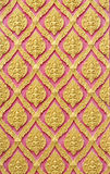 Traditional Thai style gold angels pattern on Thai temple Royalty Free Stock Photography