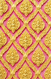 Traditional Thai style gold angels pattern on wall Royalty Free Stock Photography
