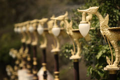 Traditional Thai style of golden swan lanterns. /lamps pole. Selective focus depth of field Royalty Free Stock Image