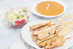 Traditional Thai style grilled pork , Moo Satay. With the sauce Royalty Free Stock Photo