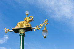 Traditional Thai style light pole with elephant statue on blue s Royalty Free Stock Photo