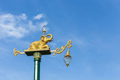 Traditional Thai style light pole with elephant statue on blue s Stock Image