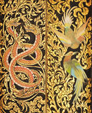 Traditional Thai style painting on temple doors Stock Photography