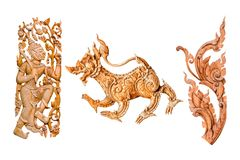 Traditional thai style pattern lion or singha and king of giant, flower wood carve on white background.  Royalty Free Stock Photo