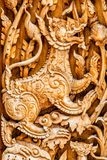 Traditional thai style pattern lion or singha wood carve.  Stock Images