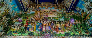 Traditional Thai style sculptures and painting in church under decoration of Wat Pariwat Temple Stock Photography