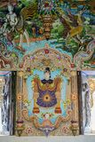 Traditional Thai style sculptures and painting in church under decoration of Wat Pariwat Temple. Traditional Thai style sculptures and painting in church under Stock Photo