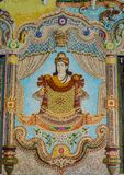 Traditional Thai style sculptures and painting in church under decoration of Wat Pariwat Temple. Traditional Thai style sculptures and painting in church under Royalty Free Stock Image