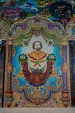 Traditional Thai style sculptures and painting in church under decoration of Wat Pariwat Temple Royalty Free Stock Photo