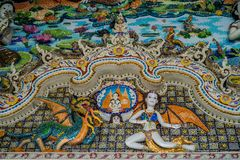 Traditional Thai style sculptures and painting in church under decoration of Wat Pariwat Temple Royalty Free Stock Image