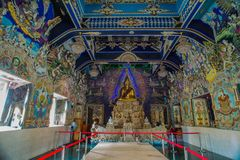Traditional Thai style sculptures and painting in church under decoration of Wat Pariwat Temple Stock Photo