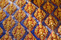 Traditional Thai style stucco on the wall of church in temple, T. Hailand Royalty Free Stock Images