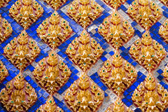 Traditional Thai style stucco on the wall of church in temple, T. Hailand Stock Photo