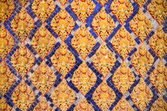 Traditional Thai style stucco on the wall of church in temple, T. Hailand Royalty Free Stock Photos