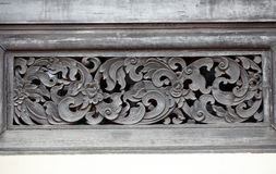 Traditional Thai style stucco. Traditional Thai style wood carving Stock Photo