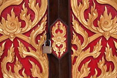 Traditional thai style on temple door Royalty Free Stock Image