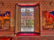 Traditional thai style temple window see through outside.  Royalty Free Stock Images