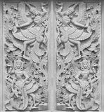 Traditional Thai style wood carving on the wall of Temple in Tha Stock Photos