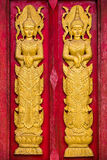 Traditional Thai style on the wooden door Royalty Free Stock Images