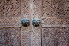 Traditional Thai style wooden door. Close up traditional Thai style wooden door Stock Image