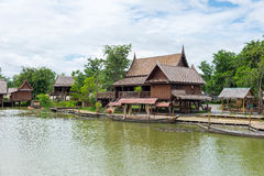 Traditional Thai style wooden house in riverside Royalty Free Stock Image