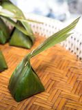 Traditional Thai sweets wrapped with Banana leaf and coconut leaf. Thailand Royalty Free Stock Photos