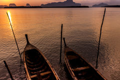 Traditional thai taxi boats at sunrise beach. Stock Images