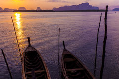 Traditional thai taxi boats at sunrise beach. Royalty Free Stock Photo